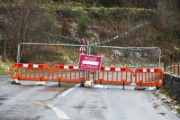 Floods;flooding;flooded;Cumbria;Lake-District;UK;weather;extreme-weather;climate-change;global-warming;deluge;torrential-rain;downpour;meteorology;low-pressure;weather-front;flood-waters;Thirlmere;A591;road;swept-away;undermined;flood-damage;road-closed;power;road-closed;barrier;road-sign