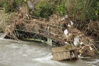 Floods;flooding;flooded;Cumbria;Lake-District;UK;Keswick;weather;extreme-weather;climate-change;global-warming;deluge;torrential-rain;downpour;meteorology;low-pressure;weather-front;rain;raining;heavy-rain;precipitation;flood-waters;river;swept-away;undermined;flood-damage;power;destroyed;destruction;flood-damage;ripped-apart;River-Greta;debris;tree;flood-debris;sediment;Fitz-Park;flattened;bridge;footbridge;washed-away