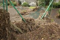 Floods;flooding;flooded;Cumbria;Lake-District;UK;Keswick;weather;extreme-weather;climate-change;global-warming;deluge;torrential-rain;downpour;meteorology;low-pressure;weather-front;rain;raining;heavy-rain;precipitation;flood-waters;river;swept-away;undermined;flood-damage;power;destroyed;destruction;flood-damage;ripped-apart;River-Greta;debris;tree;flood-debris;sediment;Fitz-Park;tennis-court;fencing;flattened