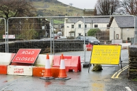 Floods;flooding;flooded;Cumbria;Lake-District;UK;Keswick;weather;extreme-weather;climate-change;global-warming;deluge;torrential-rain;downpour;meteorology;low-pressure;weather-front;rain;raining;heavy-rain;precipitation;flood-waters;river;swept-away;undermined;flood-damage;power;destroyed;destruction;flood-damage;ripped-apart;River-Gowan;stone;collapsed;bridge;stone-bridge;crossing;infrastructure;Staveley;suspended;eroded;erosion;closed;bridge-closed;barrier;road-sign;road-closed;inconvenience