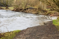 Floods;flooding;flooded;Cumbria;Lake-District;UK;Keswick;weather;extreme-weather;climate-change;global-warming;deluge;torrential-rain;downpour;meteorology;low-pressure;weather-front;rain;raining;heavy-rain;precipitation;flood-waters;river;swept-away;undermined;flood-damage;power;destroyed;destruction;flood-damage;ripped-apart;River-Greta;collapsed;bridge;crossing;infrastructure;Bridge;Keswick-railway;railway-bridge;steel;tree;scouring;erosion;river-bank