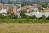 Doncaster;Yorkshire;south-Yorkshire;River-Don;river;Toll-Bar;weather;extreme-weather;rain;torrential-rain;flood;flooded;flooding;inundated;disaster;evancuated;evacuation;emergency-services;insurance;cost;global-warming;climate-change;unprecedented;extreme;street;under-water;flood-water;polluted;pollution;clean-up;costly;insurance-claim;house;housing;home;wrecked;destroyed;destruction;window;door;car;water-level;flood-level;reflection;natural-disaster;changeing-weather;weather-patterns;evacuated;cut-off;stranded;flooded-out;flooded-car;contaminated;village;community