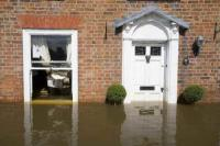 flood;flooding;flooded;disaster;natural-disaster;weather;extreme-weather;rain;rainfall;flood-plain;Gloucestershire;Tewkesbury;house;home;surrounded;marooned;cut-off;insurance;cost;expensive;UK;global-warming;climate-change;storm;river;Severn;river-Severn;River-Avon;flood-peak;flood-damage;insurance-industry;affected;evacuated;evacuation;overwhelmed;trapped;summer-floods;unprecedented;2007;July;worst-ever;climate;front-door;door;window;saturated;pollution;polluted;contamination;contaminated