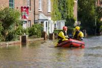 flood;flooding;flooded;disaster;natural-disaster;weather;extreme-weather;rain;rainfall;flood-plain;Gloucestershire;Tewkesbury;house;home;surrounded;marooned;cut-off;insurance;cost;expensive;UK;global-warming;climate-change;storm;river;Severn;river-Severn;River-Avon;flood-peak;flood-damage;insurance-industry;affected;evacuated;evacuation;overwhelmed;trapped;summer-floods;unprecedented;2007;July;worst-ever;climate;saturated;pollution;polluted;contamination;contaminated;washout;rescue;emergency-services;rescue-personel;boat;dinghy;inflateable;patrol;emergency