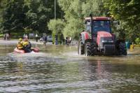 flood;flooding;flooded;disaster;natural-disaster;weather;extreme-weather;rain;rainfall;flood-plain;Gloucestershire;Tewkesbury;house;home;surrounded;marooned;cut-off;insurance;cost;expensive;UK;global-warming;climate-change;storm;river;Severn;river-Severn;River-Avon;flood-peak;flood-damage;insurance-industry;affected;evacuated;evacuation;overwhelmed;trapped;summer-floods;unprecedented;2007;July;worst-ever;climate;saturated;pollution;polluted;contamination;contaminated;washout;rescue;emergency-services;patrol;emergency;tractor;ferry;lifeline