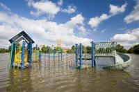 flood;flooding;flooded;disaster;natural-disaster;weather;extreme-weather;rain;rainfall;flood-plain;Gloucestershire;Tewkesbury;house;home;surrounded;marooned;cut-off;insurance;cost;expensive;UK;global-warming;climate-change;storm;river;Severn;river-Severn;River-Avon;flood-peak;flood-damage;insurance-industry;affected;evacuated;evacuation;overwhelmed;trapped;summer-floods;unprecedented;2007;July;worst-ever;climate;saturated;pollution;polluted;contamination;contaminated;washout;rescue;emergency;Tewkesbury-Abbey;Abbey;trees;clouds;aftermath;playground
