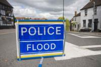 flood;flooding;flooded;disaster;natural-disaster;weather;extreme-weather;rain;rainfall;flood-plain;Gloucestershire;Tewkesbury;house;home;surrounded;marooned;cut-off;insurance;cost;expensive;UK;global-warming;climate-change;storm;river;Severn;river-Severn;River-Avon;flood-peak;flood-damage;insurance-industry;affected;evacuated;evacuation;overwhelmed;trapped;summer-floods;unprecedented;2007;July;worst-ever;climate;saturated;pollution;polluted;contamination;contaminated;washout;rescue;emergency;aftermath;housing;building-on-floodplains;road-closed;road-closure;travel;transport;travel-disruption;disruption;disrupted;police;sign