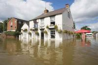 flood;flooding;flooded;disaster;natural-disaster;weather;extreme-weather;rain;rainfall;flood-plain;Gloucestershire;Tewkesbury;house;home;surrounded;marooned;cut-off;insurance;cost;expensive;UK;global-warming;climate-change;storm;river;Severn;river-Severn;River-Avon;flood-peak;flood-damage;insurance-industry;affected;evacuated;evacuation;overwhelmed;trapped;summer-floods;unprecedented;2007;July;worst-ever;climate;saturated;pollution;polluted;contamination;contaminated;washout;rescue;emergency;aftermath;housing;building-on-floodplains;infrastructure;pub;public-house;White-Bear;business