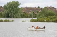 flood;flooding;flooded;disaster;natural-disaster;weather;extreme-weather;rain;rainfall;flood-plain;Gloucestershire;Tewkesbury;house;home;surrounded;marooned;cut-off;insurance;cost;expensive;UK;global-warming;climate-change;storm;river;Severn;river-Severn;River-Avon;flood-peak;flood-damage;insurance-industry;affected;evacuated;evacuation;overwhelmed;trapped;summer-floods;unprecedented;2007;July;worst-ever;climate;saturated;pollution;polluted;contamination;contaminated;washout;rescue;emergency;aftermath;housing;building-on-floodplains;infrastructure;riverside;rowing-boat;Tewkesbury-Abbey;escape
