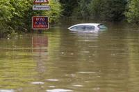 flood;flooding;flooded;disaster;natural-disaster;weather;extreme-weather;rain;rainfall;flood-plain;Gloucestershire;Tewkesbury;house;home;surrounded;marooned;cut-off;insurance;cost;expensive;UK;global-warming;climate-change;storm;river;Severn;river-Severn;River-Avon;flood-peak;flood-damage;insurance-industry;affected;evacuated;evacuation;overwhelmed;trapped;summer-floods;unprecedented;2007;July;worst-ever;climate;saturated;pollution;polluted;contamination;contaminated;washout;rescue;emergency;aftermath;housing;building-on-floodplains;infrastructure;riverside;vehicle;destroyed;washed-away;danger;risk;car;driving;travel