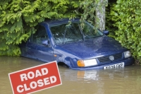 flood;flooding;flooded;disaster;natural;disaster;weather;extreme;weather;rain;rainfall;flood;plain;Gloucestershire;Tewkesbury;house;home;surrounded;marooned;cut;off;insurance;cost;expensive;UK;global;warming;climate;change;storm;river;Severn;river;Severn;red;sign;road-sign;warning;warning-sign;road-closed;closed