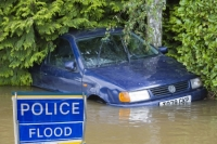 flood;flooding;flooded;disaster;natural;disaster;weather;extreme;weather;rain;rainfall;flood;plain;Gloucestershire;Tewkesbury;house;home;surrounded;marooned;cut;off;insurance;cost;expensive;UK;global;warming;climate;change;storm;river;Severn;river;Severn;sign;warning;police;blue;police-flood
