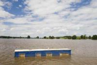 flood;flooding;flooded;disaster;natural-disaster;weather;extreme-weather;rain;rainfall;flood-plain;Gloucestershire;Tewkesbury;house;home;surrounded;marooned;cut-off;insurance;cost;expensive;UK;global-warming;climate-change;storm;river;Severn;river-Severn;River-Avon;flood-peak;flood-damage;insurance-industry;affected;evacuated;evacuation;overwhelmed;trapped;summer-floods;unprecedented;2007;July;worst-ever;climate;saturated;pollution;polluted;contamination;contaminated;washout;rescue;emergency;aftermath;housing;building-on-floodplains;infrastructure;riverside;water;risk;dangerous;washed-away;summer-holiday;holiday;caravan;caravan-park;destroyed;destruction;water-power;inundated;Upton-upon-Severn;precarious