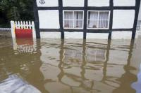 flood;flooding;flooded;disaster;natural-disaster;weather;extreme-weather;rain;rainfall;flood-plain;Gloucestershire;Tewkesbury;house;home;surrounded;marooned;cut-off;insurance;cost;expensive;UK;global-warming;climate-change;storm;river;Severn;river-Severn;River-Avon;flood-peak;flood-damage;insurance-industry;affected;evacuated;evacuation;overwhelmed;trapped;summer-floods;unprecedented;2007;July;worst-ever;climate;saturated;pollution;polluted;contamination;contaminated;washout;rescue;emergency;aftermath;housing;building-on-floodplains;infrastructure;riverside;water;risk;dangerous;destroyed;destruction;water-power;inundated;Kempsey;Worcestershire;old;ancient;flood-protection;timber-framed;thatched;cottage