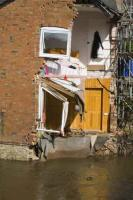 flood;flooding;flooded;disaster;natural-disaster;weather;extreme-weather;rain;rainfall;flood-plain;Gloucestershire;Tewkesbury;house;home;surrounded;marooned;cut-off;insurance;cost;expensive;UK;global-warming;climate-change;storm;river;Severn;river-Severn;River-Avon;flood-peak;flood-damage;insurance-industry;affected;evacuated;evacuation;overwhelmed;trapped;summer-floods;unprecedented;2007;July;worst-ever;climate;saturated;pollution;polluted;contamination;contaminated;washout;rescue;emergency;aftermath;housing;building-on-floodplains;infrastructure;riverside;water;risk;dangerous;destroyed;destruction;water-power;inundated;old;ancient;Shropshire;Ludlow;river-Corve;bed;hanging;precarious;floorboards;floor;sloping;collapse;undermined;radiator;double-bed;earth-move;did-the-earth-move