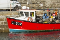 Cornwall;UK;coast;sea;Portreath;harbour;boat;red;fishing-boat;tidal;high-tide;moored;mooring;fisherman