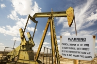 USA;US;America;California;drought;climate-change;global-warming;Kern-County;Bakersfield;drought;desicated;Kern-River-oilfield;oil;oilfield;oil-production;oil-pump;nodding-donkey;oil-well;fossil-fuel;crude-oil;raw-material;carbon;Oildale;warning;sign;chemicals;cancer;carcinogenic;law;birth-defects;reproductive-harm;reproduction;composite