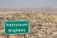 USA;US;America;California;drought;climate-change;global-warming;Kern-County;Bakersfield;drought;desicated;Midway-Sunset-oilfield;oil;oilfield;oil-production;oil-pump;nodding-donkey;oil-well;fossil-fuel;crude-oil;raw-material;carbon;wasteland;pipe;piping;oil-derrick;drilling-rig;fracking;oil-well;drilling;industry;heavy-industry;Taft;fracked;fracking;polluted;contaminated;composite;sing;road-sign;highway;petroleum;petroleum-highway