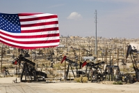 USA;US;America;California;drought;climate-change;global-warming;Kern-County;Bakersfield;drought;desicated;Midway-Sunset-oilfield;oil;oilfield;oil-production;oil-pump;nodding-donkey;oil-well;fossil-fuel;crude-oil;raw-material;carbon;wasteland;pipe;piping;oil-derrick;drilling-rig;fracking;oil-well;drilling;industry;heavy-industry;Taft;fracked;fracking;polluted;contaminated;composite;flag;red;blue;stars-and-stripes;petriot;patriotic;pride