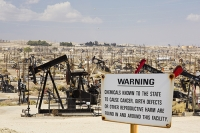 USA;US;America;California;drought;climate-change;global-warming;Kern-County;Bakersfield;drought;desicated;Midway-Sunset-oilfield;oil;oilfield;oil-production;oil-pump;nodding-donkey;oil-well;fossil-fuel;crude-oil;raw-material;carbon;wasteland;pipe;piping;oil-derrick;drilling-rig;fracking;oil-well;drilling;industry;heavy-industry;Taft;fracked;fracking;polluted;contaminated;warning;sign;chemicals;cancer;carcinogenic;law;birth-defects;reproductive-harm;reproduction;composite