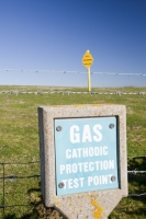 Barrow-in-Furness;Cumbria;UK;sign;warning;gas;natural-gas;pipe;pipeline;blue;yellow;sky;contrast;Morecambe-Bay;gas-field;fossil-fuel;energy;power;climate-change;global-warming;cathodic;test;testing;fence;barbed-wire