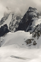 Chamonix;france;Alps;French-Alps;mountain;summit;Aiguille-Du-Midi;cable-car-station;cloud;mist;Mont-Blanc;glacier;crevasse;glacial-retreat;Glacier;climate-change;serac;global-warming;receding;retreating;snow;snow-pack;slope;steep;permafrost;permafrost-melt;cloudy;fog;foggy;misty;hole;window;vista;view;Mont-Blanc-Du-Tacul;revealed;crevasse;Vallee-blanche;mountaineer;climber;remote;altitude;explore;rocky;cliff;crag