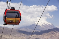 South-America;Bolivia;La-Paz;city;house;housing;dense;density;slope;hilly;Andes;mountain;altitude;high;infrastructure;cable-car;transport;cable;cabin;telecabin;lift;investment;modern;overcrowded;population;El-Alto;Illimani;snow;glacier;solar-panel;renewable;renewable-energy;PV;photo-voltaic