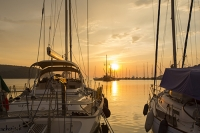 Sivota;Greece;Mediterranean;sea;coast;ship;marine;boat;fishing-boat;yacht;sailing;sailing-boat;boat;harbour;haven;lagoon;shallow;water;holiday;tropical;warm;hot;tranquill;calm;serene;harbour;port;sunset;evening;glow;warm;light;waterfront