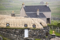 Lewis;Isle-of-Lewis;Outer-Hebrides;hebrides;Scotland;UK;cabin;hut;old;window;shed;house;black-house;hostel;Garenin;Carloway;thatch;thatched;roof;preserved;contrast