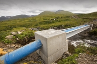 Scotland;Power;UK;renewable;renewable-energy;Hydro;Hydro-power;HEP;Power-Station;electricty;green;carbon-neutral;climate-change;global-warming;low-carbon;electric;Mull;Isle-of-Mull;Inner-Hebrides;Ben-more;munro;estate;construction;sign;small-scale;700Kw;generating;investment;green-jobs;sustainable;sustainable-construction;river;Kilfinichen;bridge;blue;pipe;piping;pipeline;hydro-pipe
