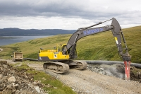 Scotland;Power;UK;renewable;renewable-energy;Hydro;Hydro-power;HEP;Power-Station;electricty;green;carbon-neutral;climate-change;global-warming;low-carbon;electric;Mull;Isle-of-Mull;Inner-Hebrides;Ben-more;munro;estate;construction;sign;small-scale;700Kw;generating;investment;green-jobs;sustainable;sustainable-construction;river;Kilfinichen;pipeline;hydro-pipe;plant;machinary;yellow;digger;JCB;jack-hammer;rock-breaking