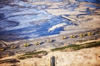 tar-sand;tar-sands;oil-sand;oil-sands;oil-industry;fossil-fuel;climate-change;global-warming;industry;heavy-industry;industrial;Athabasca;Alberta;Canada;destruction;pollution;contamination;contaminated;strip-mining;Fort-McMurray;sky;environment;environmental-destruction;carbon-footprint;statement;affected;Boreal-Forest;toxic;oil;bitumen;deposits;oil-reserves;emissions;carbon-footprint;energy;aerial;aerial-photograph;soil;overburden;oil-slick;oil-spill;dump-truck;haulage;road
