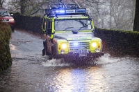 weather;extreme-weather;environment;rain;rainfall;exceptional;global-warming;deluge;climate-change;Cumbria;Lake-District;flood;flooding;flood-damage;destruction;water;water-power;river;flood-damage;policeman;road-block;stopping;torrential;downpour;mountain-rescue;landrovet;four-wheel-drive