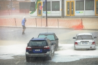 Melbourne;Victoria;Australia;weather;severe-weather;extreme-weather;storm;tropical-storm;hail;rain;torrential-rain;climate-change;global-warming;damage;cost;insurance;wet;downpour;car;car-park;hail;hail-storm;flood;flooded;man;bag;shelter;caught-out;soaked