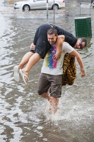 Melbourne;Victoria;Australia;weather;severe-weather;extreme-weather;storm;tropical-storm;hail;rain;torrential-rain;climate-change;global-warming;damage;cost;insurance;wet;downpour;flood;flooding;flooded;street;road;wade;wading;carry;carrying;male;man;friend