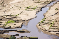 Malawi;Africa;flood;floods;flooding;African;disaster;climate-change;global-warming;refugee;Shire-Valley;destroyed;destruction;river-bank;eroded;erosion;washed-away;flood-debris;farming;agriculture;subsistence;Shire-River;aerial;aerial-photography;flood-debris;sand;person;farmer