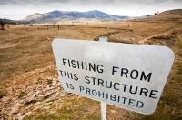 New-South-Wales;Australia;Lake-Hume-climate-change;global-warming;drought;dry;dried-up;water-supply;water-levels;lake;reservoir;water-shortage;tree;dead;revealed;shore;lake-shore;tree;dead;skeleton;fishing;no-fishing;sign;pointless