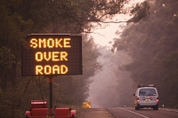 Australia;tree;sunrise;dawn;colour;glow;smoke;smoky;bush-fire;fire;forest-fire;visibility;Orbost;New-south-Wales;Eucalyptus;controlled-burn;controlled-burning;road;road-sign;matrix-sign;warn;warning