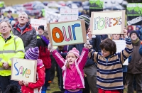 Grizedale;Grizedale-forest;wood;woodland;trees;Forestry-Commission;Lake-District;Cumbria;UK;public;gathering;crowd;protest;protesting;protester;banner;placard;politics;proposal;Conservative;coalition;government;angry;voice;people-power;influence;child;children;family;siblings;brother;sister