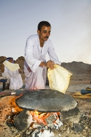 Egypt;Sinai;desert;sinai-desert;Dahab;Red-Sea;sand;sandy;rocky;outcrop;sky;night;sky;star;bedouin;arab;arabic;guide;light;camp;camping;nomad;nomadic;lifestyle;culture;arab;arabic;man;male;fire;cook;cooking;bread;prepare;meal;flame;food;meal