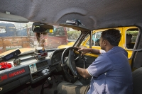 Calcutta;Bengal;India;taxi-man;male-driver;taxi-driver;congestion;rush-hour;traffic-jam;street;steering-wheel;delay;chocked;no-smoking;interior;old;shabby;dilapidated