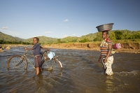 Malawi;Africa;flood;floods;flooding;displaced;African;disaster;disaster-relief;climate-change;global-warming;refugee;poor;poverty-Shire-Valley;destroyed;destruction;river-bank;eroded;erosion;undercut;washed-away;infrastructure;river;washed-away;boy;African;Chikwawa;bike;bicycle;carry;carrying;washed-away;child;woman;baby;carrying;head;balance;balancing