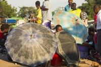 Malawi;Africa;Shire-Valley;Chikwawa;marekt;road;African-market;market-stall;crowds;retail;economy;women;shade;umbrella;parasol