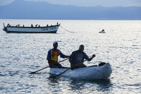 Malawi;Africa;Lake-Malawi;Cape-Maclear;sunlight;tropics;boat;tranquil;peaceful;water;man;male;Black;African;canoe;dug-out-canoe;traditional;fishing;fisherman;paddle;paddling;lake-fish;bird;Cormorant;sunset;dusk