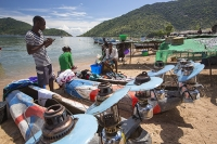 Malawi;Africa;Lake-Malawi;Cape-Maclear;sunlight;tropics;boat;tranquil;peaceful;water;canoe;dug-out-canoe;traditional;blue;beach;sand;sandy;sandy-beach;child;children;Black;african;fishing;light;lamp;lantern;parafin-lamp