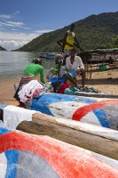 Malawi;Africa;Lake-Malawi;Cape-Maclear;sunlight;tropics;boat;tranquil;peaceful;water;canoe;dug-out-canoe;traditional;blue;beach;sand;sandy;sandy-beach;child;children;Black;african;fishing;red;white;blue
