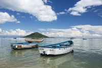 Malawi;Africa;Lake-Malawi;Cape-Maclear;sunlight;tropics;boat;tranquil;peaceful;water;canoe;dug-out-canoe;traditional;blue;beach;sand;sandy;sandy-beach;fishing