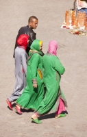 Morocco;North-africa;islamic;muslim;arabic;Marrakech;people;square;Djemaa-el-Fna;busy;women;woman;female;Islamic;Muslim;faith;religion;scarf;hijab;burkha;covered-up;clothing;clothes;tradition;traditional;sexism;sexist;Berber;green