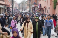 Morocco;North-africa;islamic;muslim;arabic;Marrakech;tourism;crowds;crowd;people;square;Djemaa-el-Fna;busy;population;tourism;souk;road;street;over-populated;human-population;crammed;intense;muslim;Berber;woman;burkha;islam;islamic