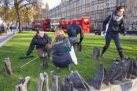 flood;flooding;floods;London;UK;Greenpeace;charity;NGO;protest;art;instalation;pop-up-art;protest;protesting;activist;envirnoment;art;wellies;wellington-boots;rubber-boots;message;communication;flood-victim;volunteer;Westminster;stunt;PR;red;bus;London-Bus;public-transport